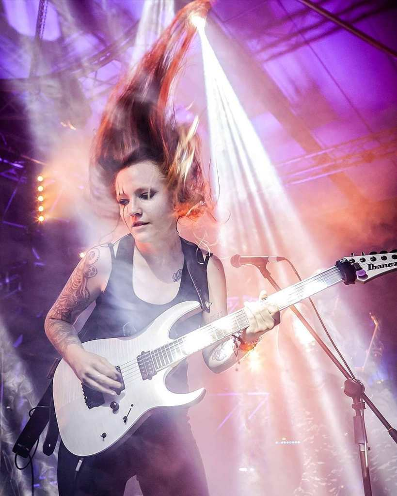 A photo of Robyn Ferguson, a female guitarist and musician from South Africa